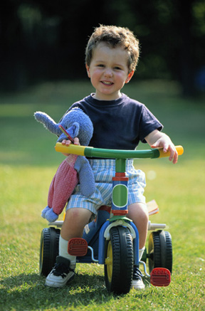boy on tricycle photo